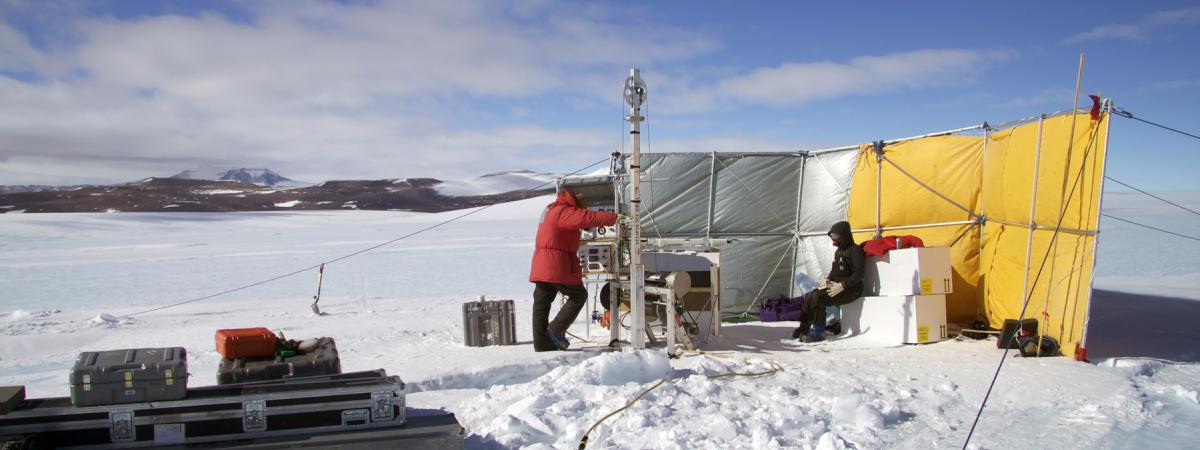 Two scientists drill an ice core at Allan Hills, Antarctica