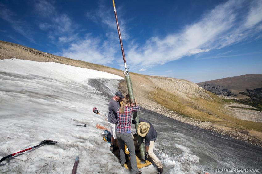 A field team led by Craig Lee (INSTAAR, UC-Boulder) and co-principal investigators David McWethy (Montana State University) and Greg Pederson (US Geological Survey) use the Prairie Dog Drill to recover a core from an ice patch in the Greater Yellowstone Area