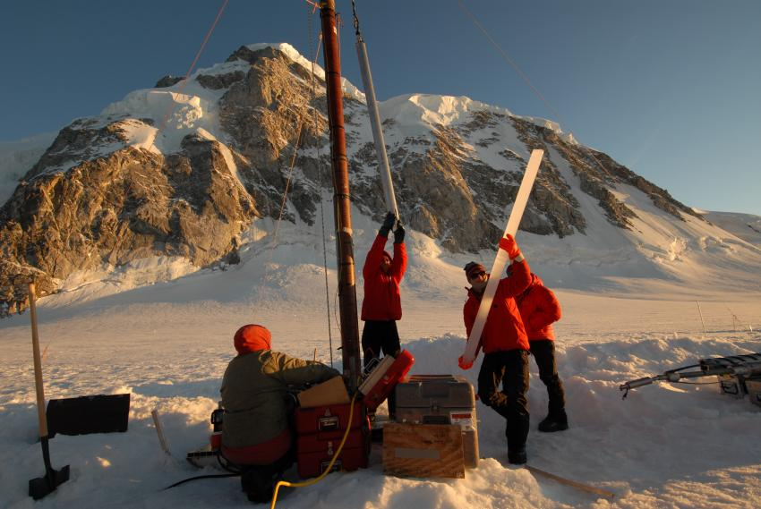 A 2-meter-long section of ice from Combatant Col, Mt. Waddington, British Columbia, is removed from the Thermal Drill