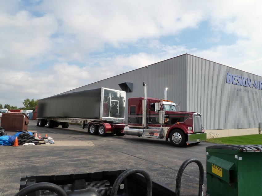 The loaded Conestoga trailer leaves the IDP-Wisconsin Warehouse, bound for Port Hueneme, CA