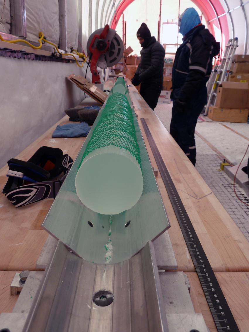 Cutting the 2-meter long sections of brittle ice into 1-meter long sections