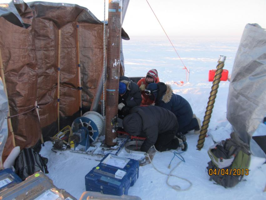 Drilling with the thermal drill during the 2013 field season in SE Greenland to investigate liquid water storage in the perennial firn aquifer