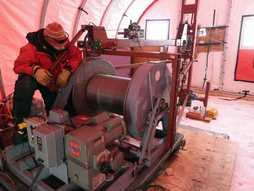 IDP driller/winch operator Elizabeth Morton assists with borehole logging operations at WAIS Divide, Antarctica
