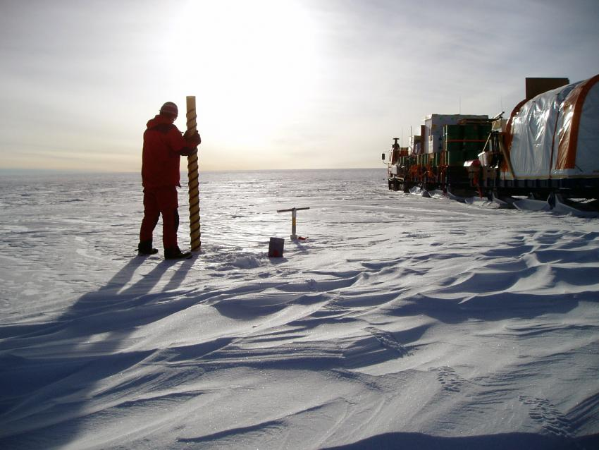 A scientist uses a PICO hand auger in the middle of East Antarctica during the Norwegian-U.S. Traverse of East Antarctica