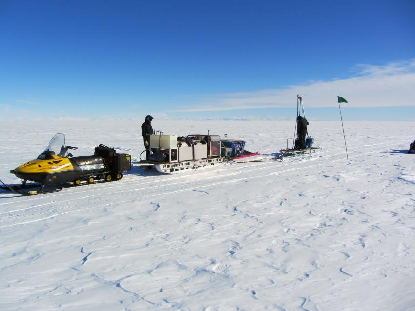 Drilling seismic shot holes with the Small Hot Water Drill on Beardmore Glacier, Antarctica, during the 2012-2013 summer field season