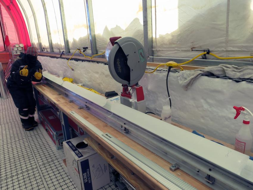 Mindy Nicewonger at the core processing station inside the drill tent for the South Pole Ice Core project