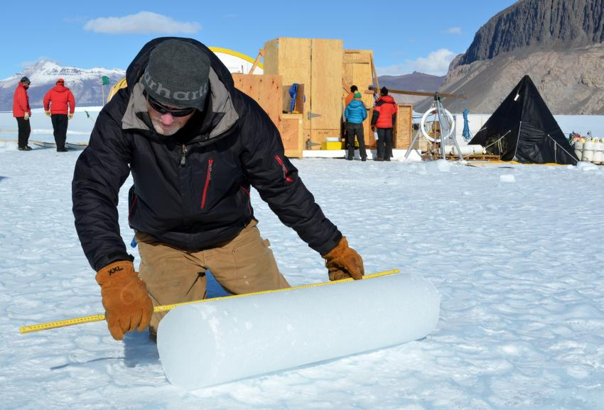 IDP driller Mike Jayred measures an ice core atop of Taylor Glacier during the 2013/14 Antarctic field season