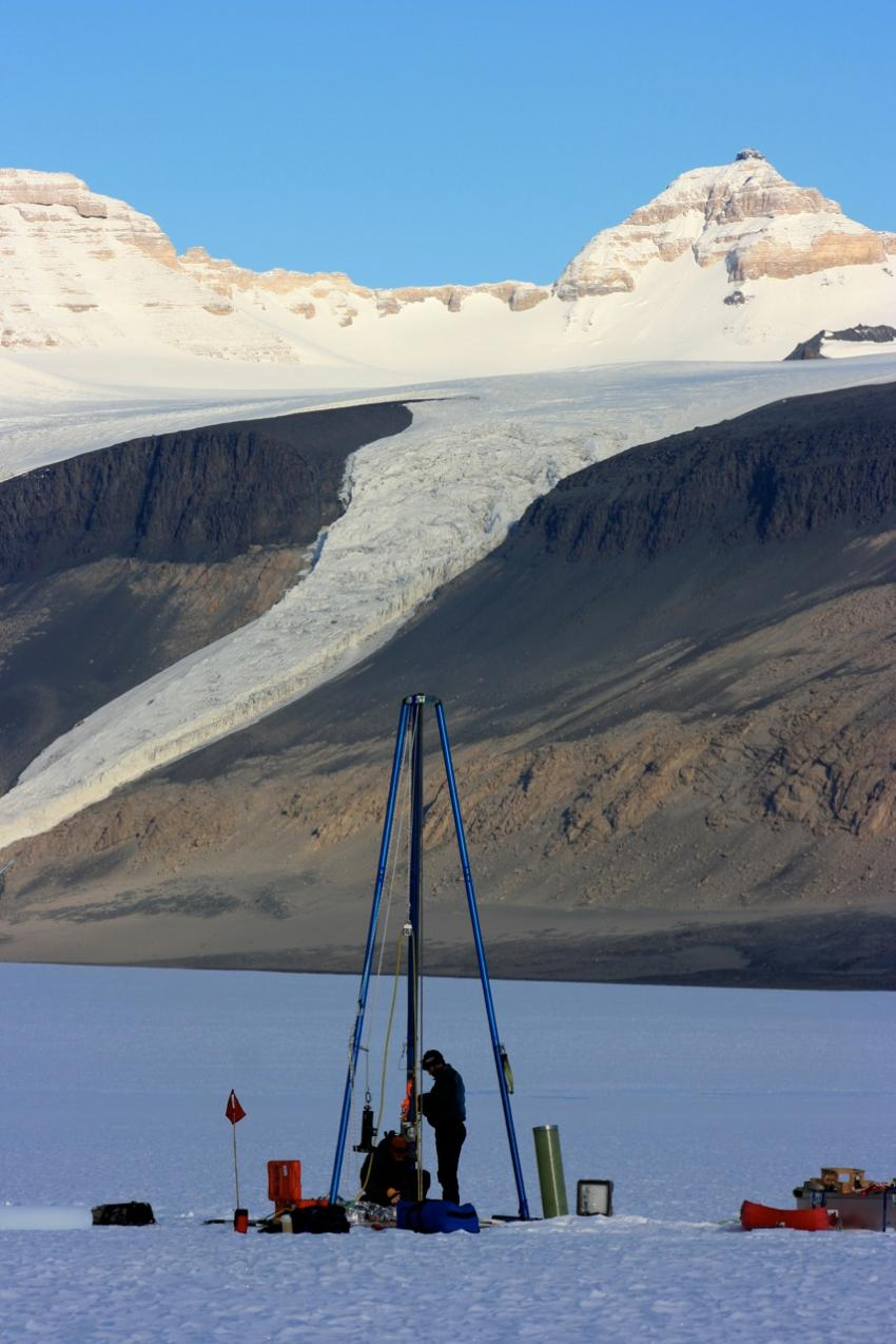 Two IDP drillers assemble the Blue Ice Drill at Taylor Glacier, Antarctica, during the 2010/11 field season