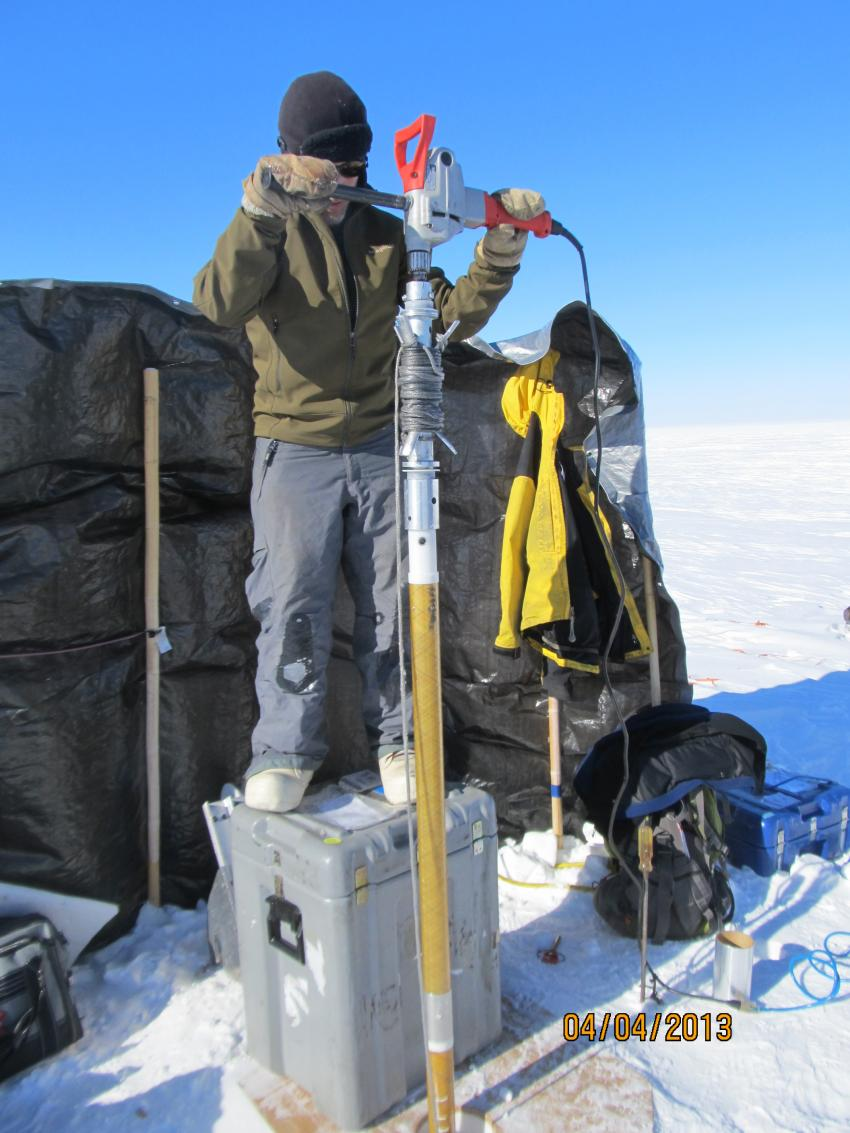 IDP driller Jay Kane drills with the PICO Hand Auger and Sidewinder system during the 2013 field season in SE Greenland