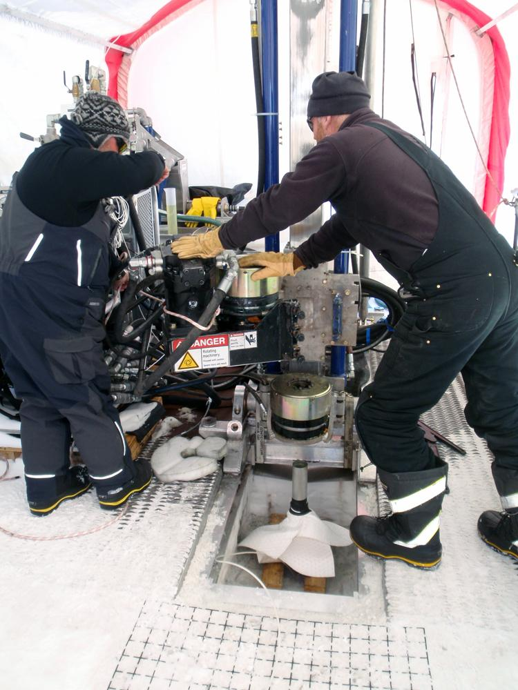 IDDO drillers Clayton Armstrong (at left) and Mike Jayred (at right) operating the ASIG Drill at Pirrit Hills
