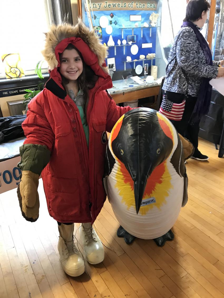 Students and their parents engage in hands-on activities while learning about ice core science and the challenges of working in the polar regions.