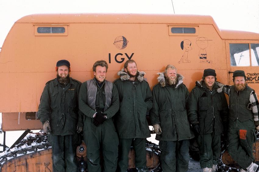 Charles Bentley, far left, and the rest of the Byrd Station traverse team pose in front of a Tucker Sno-Cat in February 1958 after a season of discoveries around West Antarctica