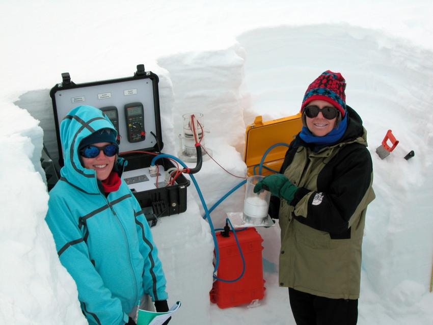 Alden and Mary measuring permeability of surface snow at Summit, Greenland, summer 2011
