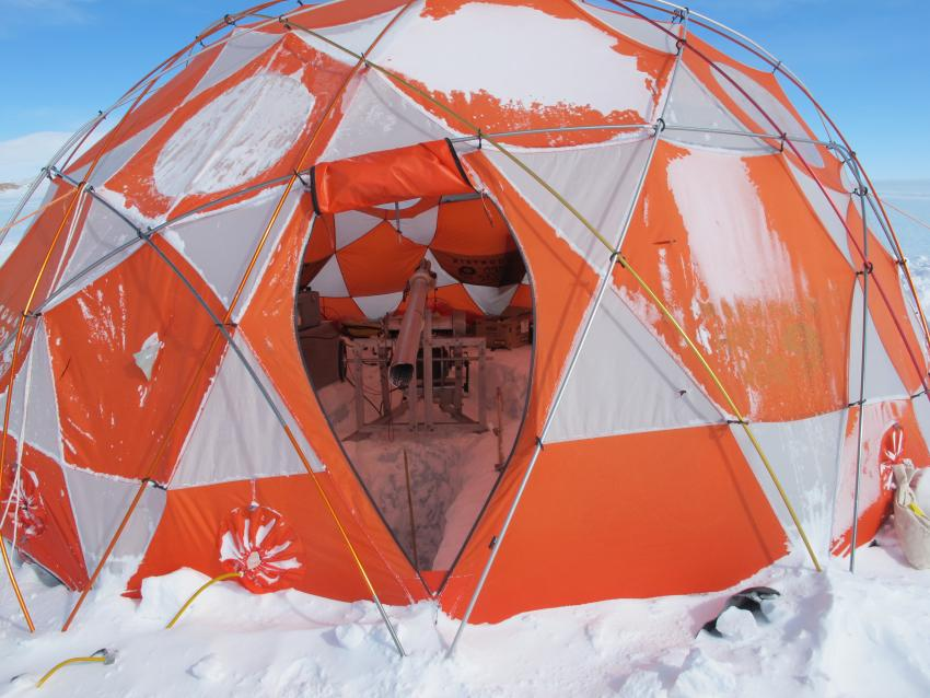 Drilling tent and Eclipse Drill in operation at a snowy Allan Hills, Antarctica