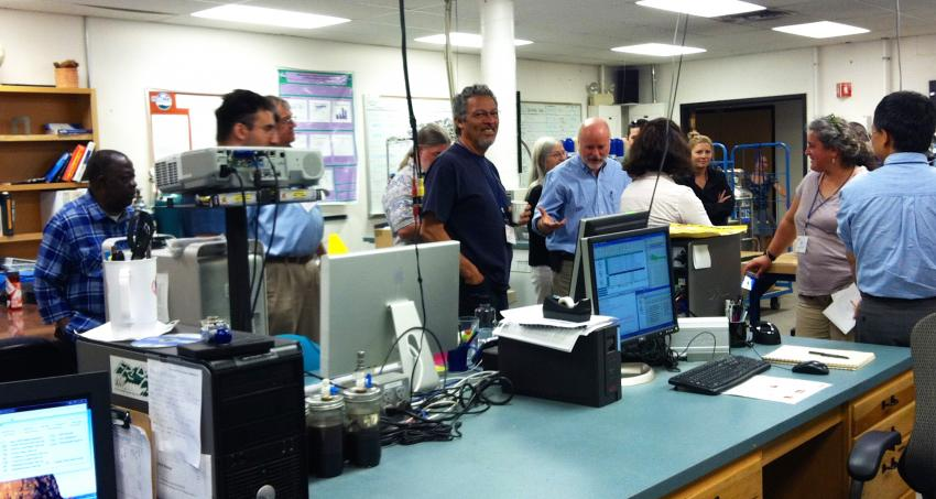 School of Ice partner Bruce Vaughn leads 2015 professors on a tour of CU- INSTAAR's stable isotope laboratory