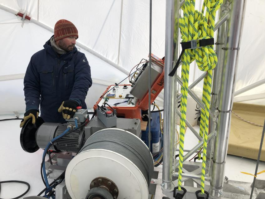Tanner Kuhl operates the Blue Ice Drill with a new tower at Allan Hills, Antarctica, during the 2019/20 field season.